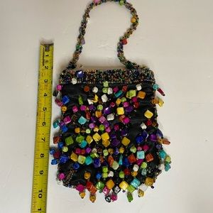 Small hand bag with multi colored glass beads